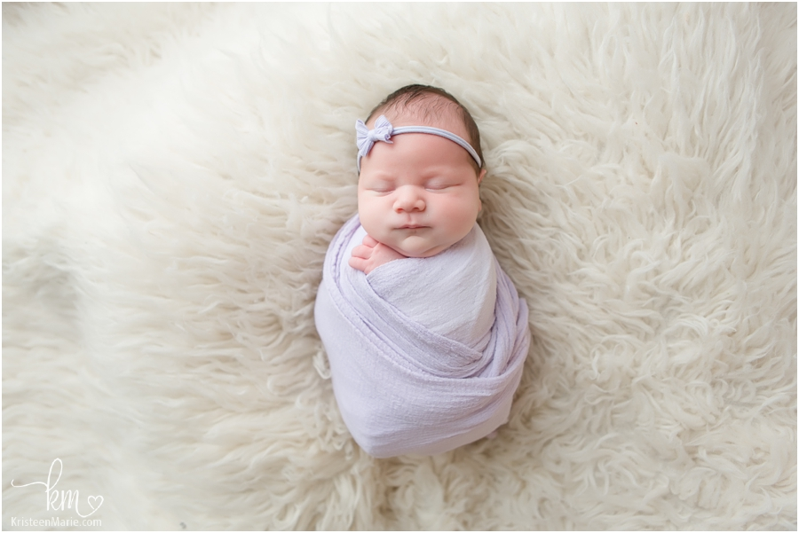 sweet newborn girl in purple