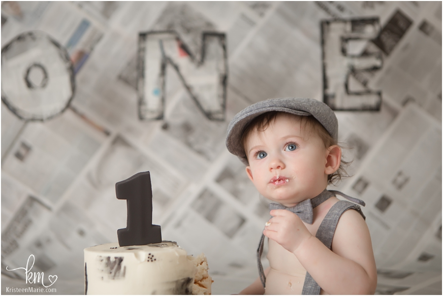newspaper themed cake smash session for 1st birthday theme