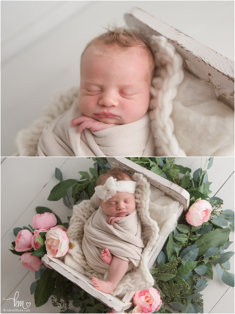 newborn in bed with floral