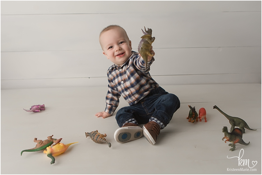 little boy playing with dinos