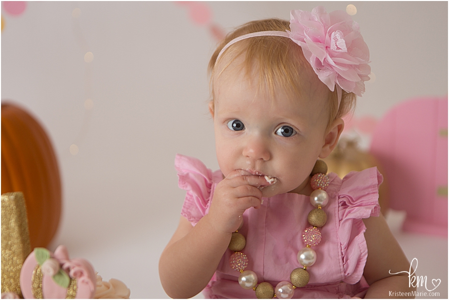 little girl with pink and gold