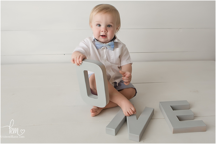 little boy with bow tie first birthday