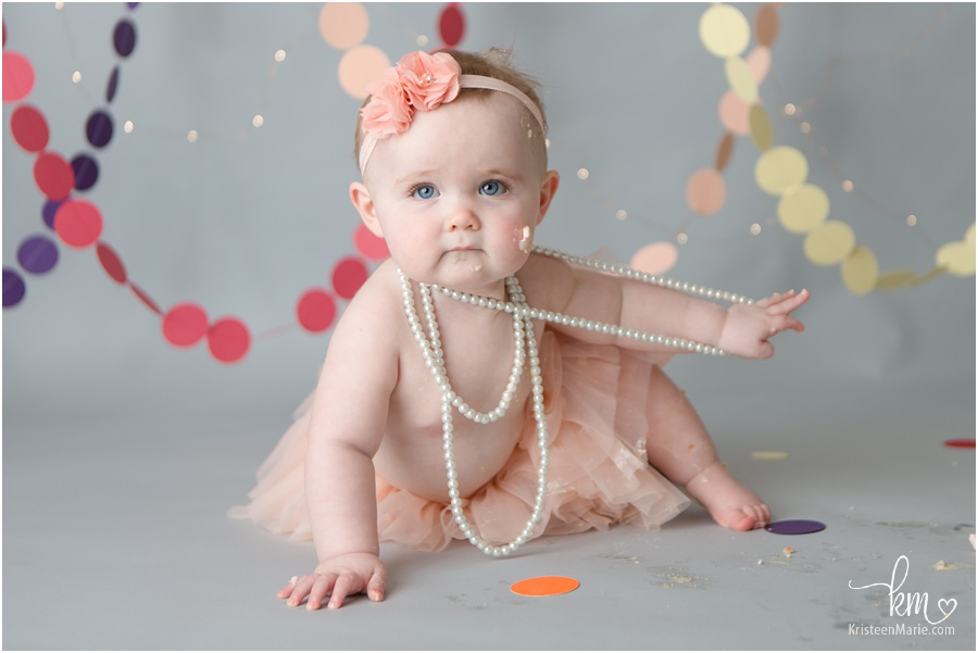 birthday girl in pink playing with pearls