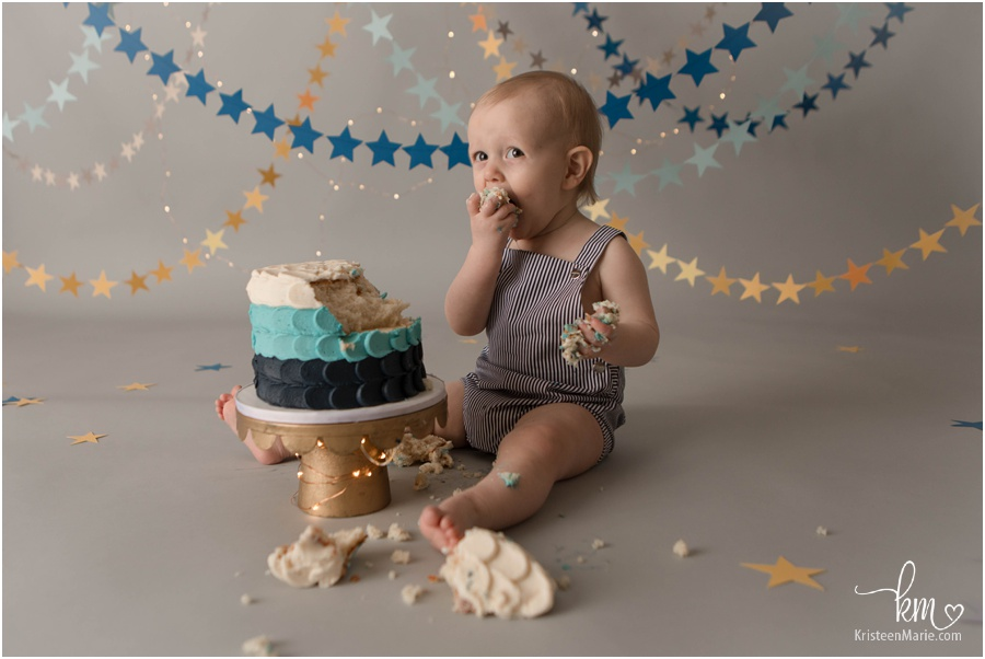 blue and gold start birthday cake smash for one year old