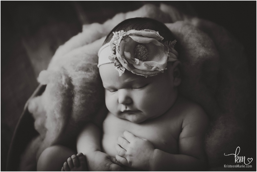 cuddly newborn baby girl in black and white