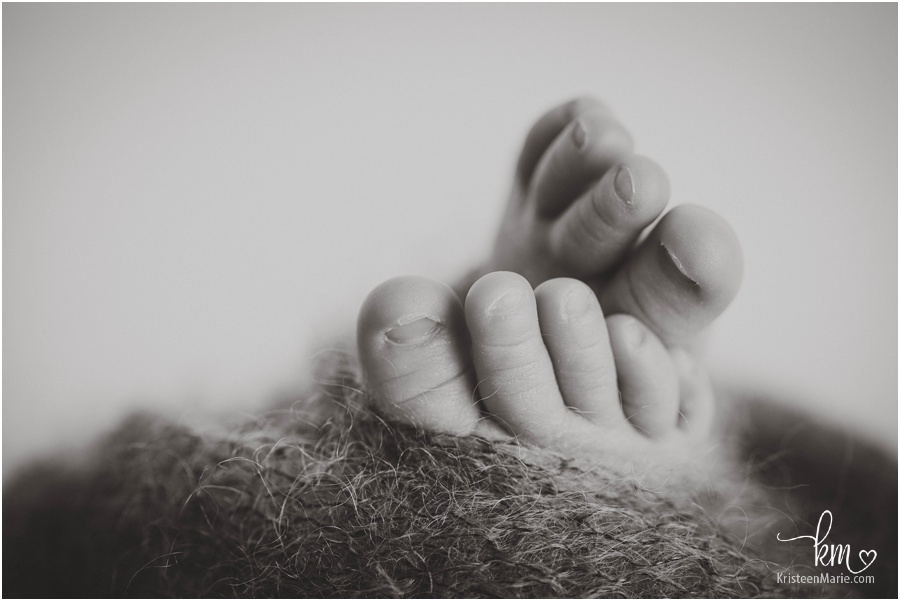 tiny newborn baby feet - black and white image