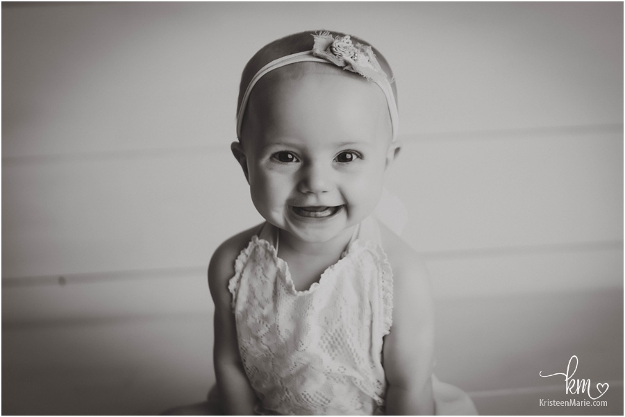 smiling sitting baby in black and white