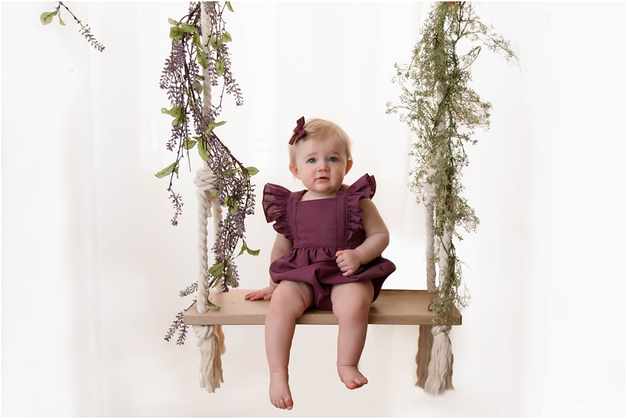baby one swing in studio with greenery