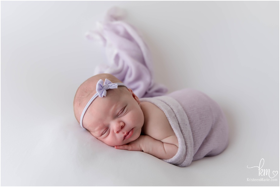 baby in purple on white - Indianapolis newborn photography