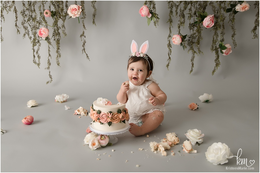 1st birthday cake smash with blush pink flowers and greenery