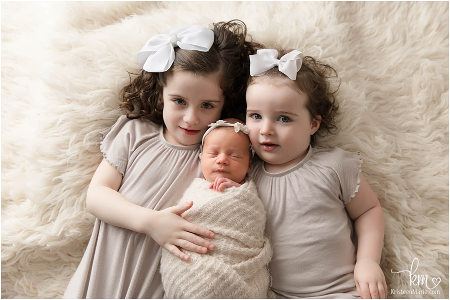 three siblings - newborn baby sister
