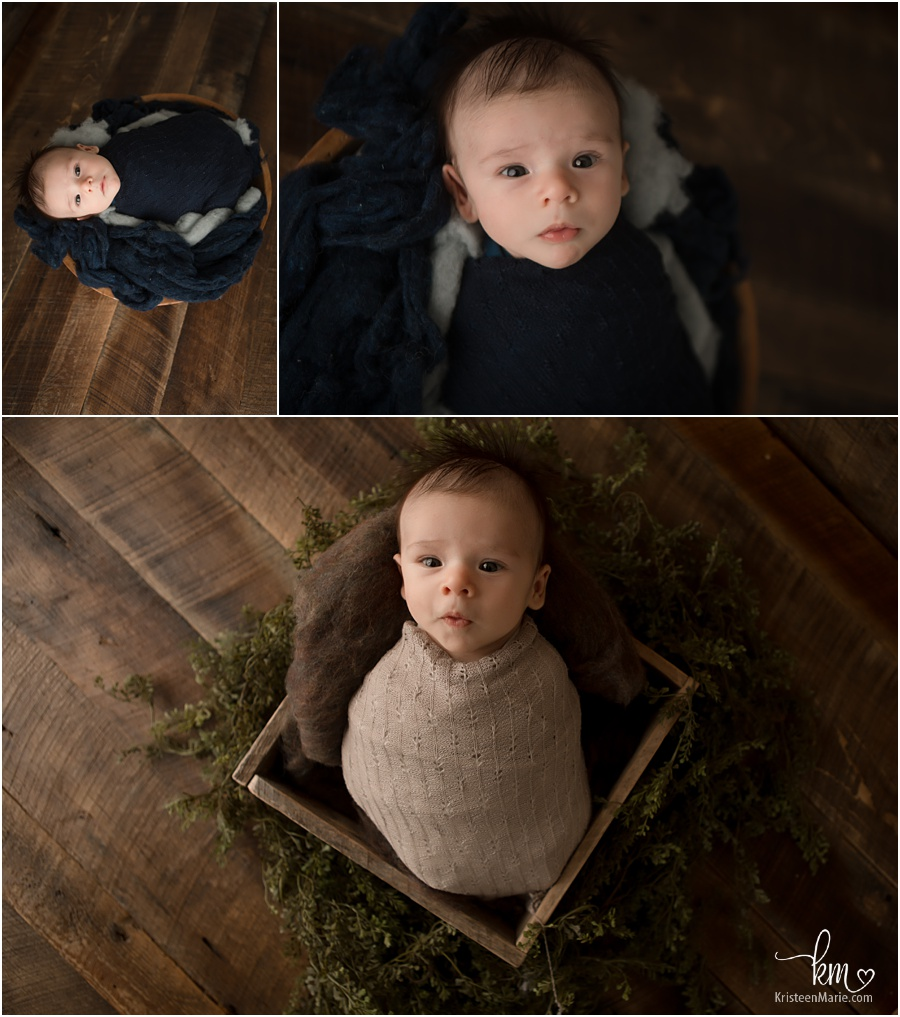 newborn boy on dark wood