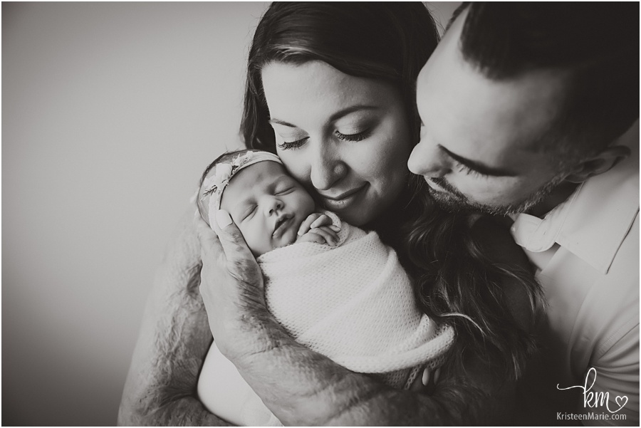 black and white newborn photography image with parents