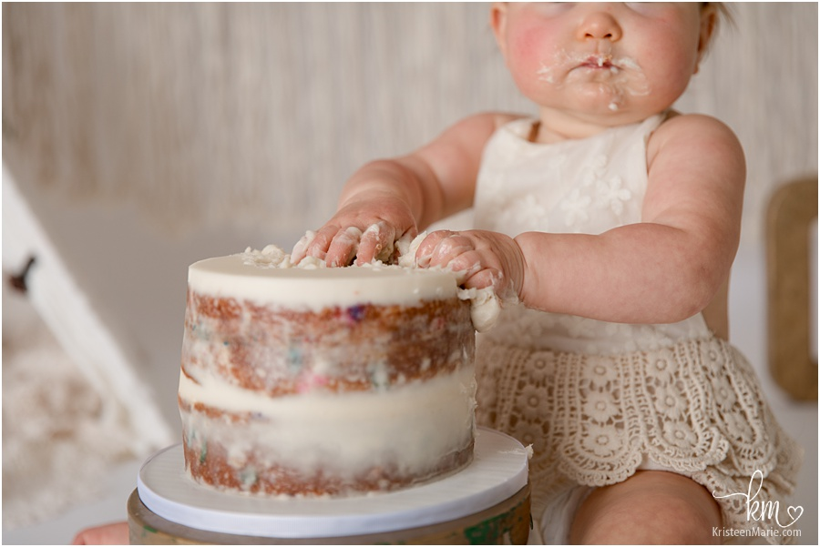 chubby baby fingers eating cake