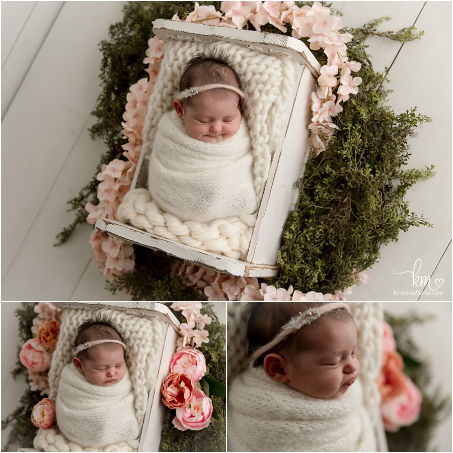 newborn girl with pink flowers set-up