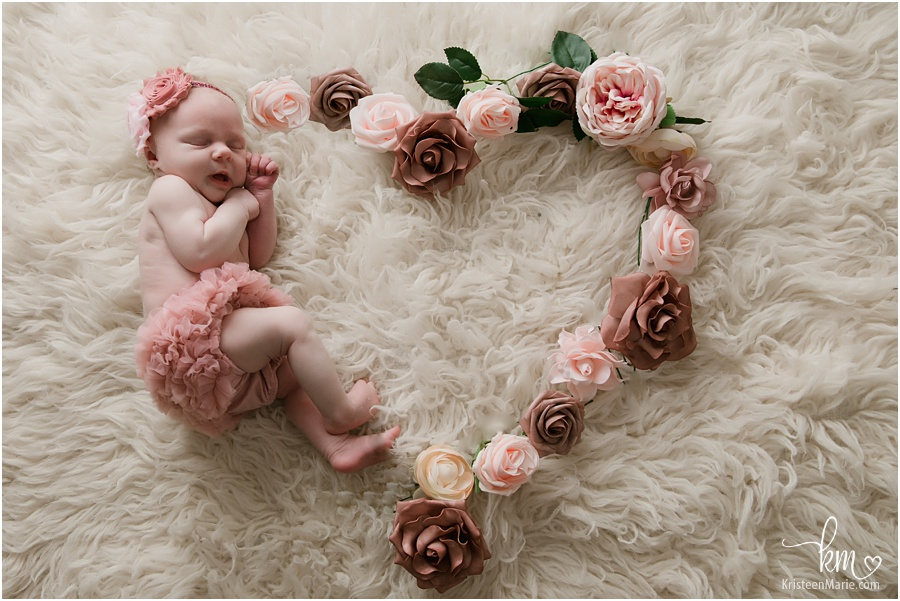 baby girl in heart flower