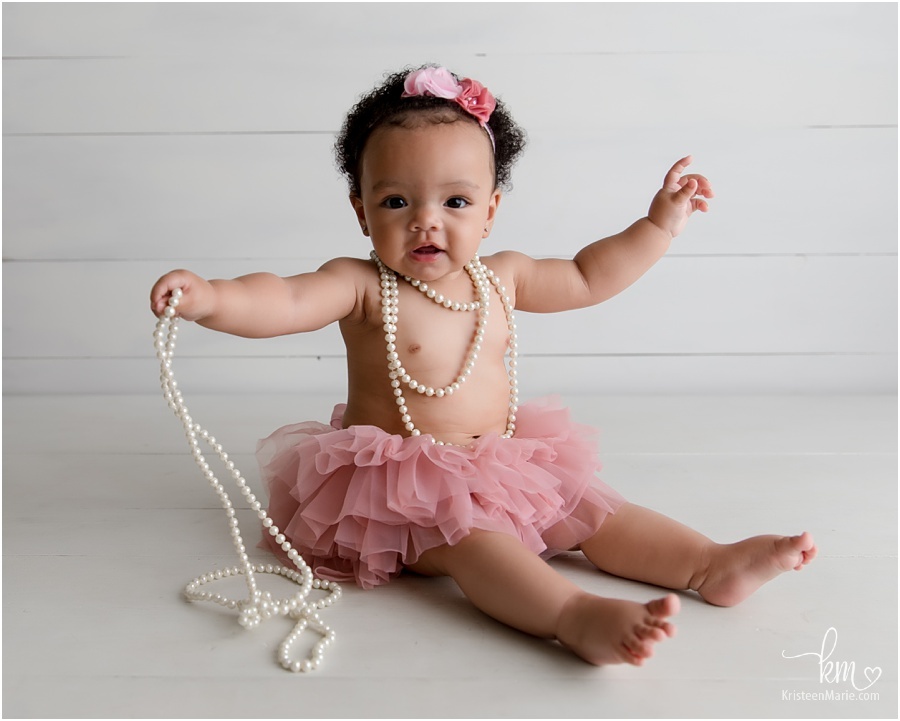 baby girl with pearls