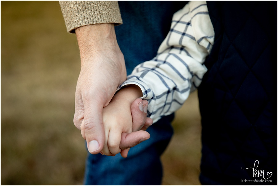 holding dad's hand