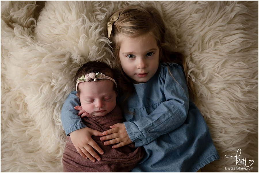 sisters - 2 year old and newborn