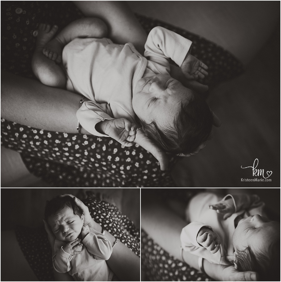 newbor girl in mom's hands - back and white newborn photography