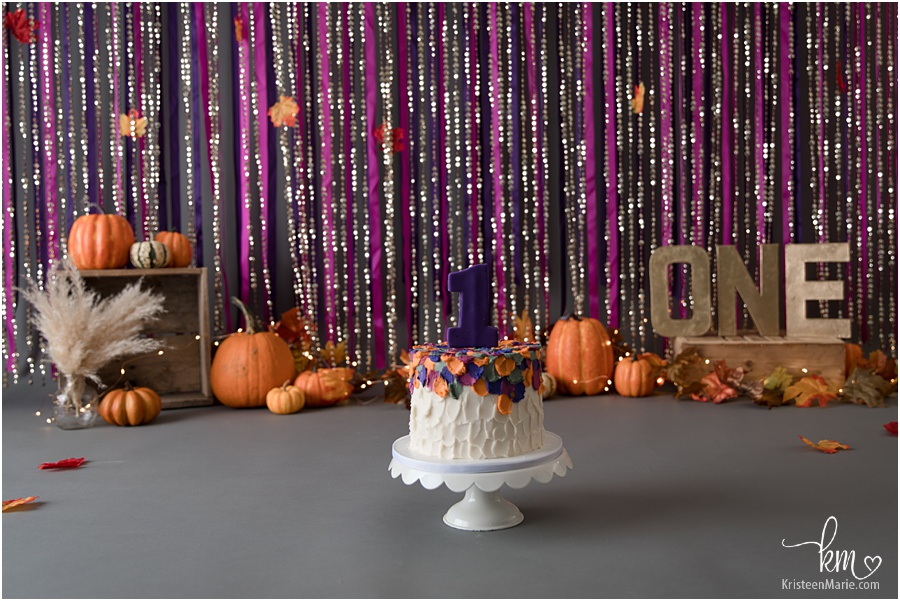 pumpkin smash cake - pink, gold, purple, and organge