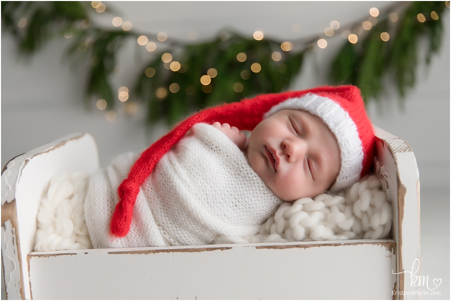 Christmas newborn picture - santa hat and twinkle lights