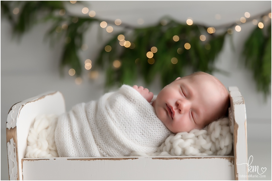 Christmas newborn picture - classic image with twinkle lights