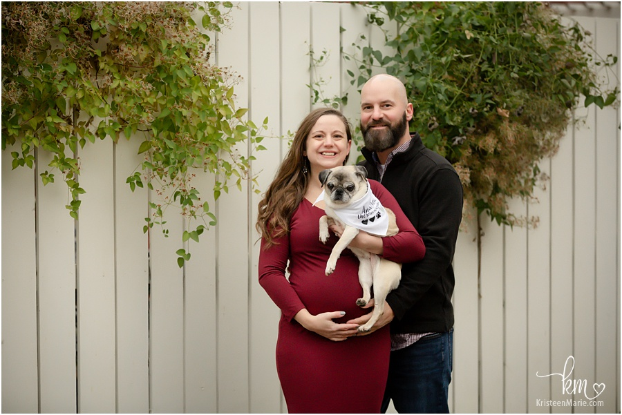 expecting couple with pup