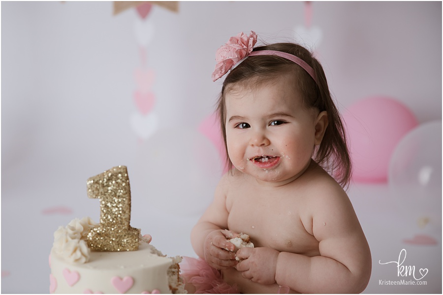 pink and gold 1st birthday cake smash