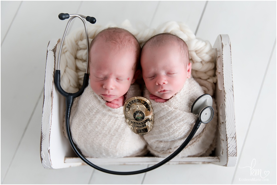 nurse and police man newborn picture with twin boys