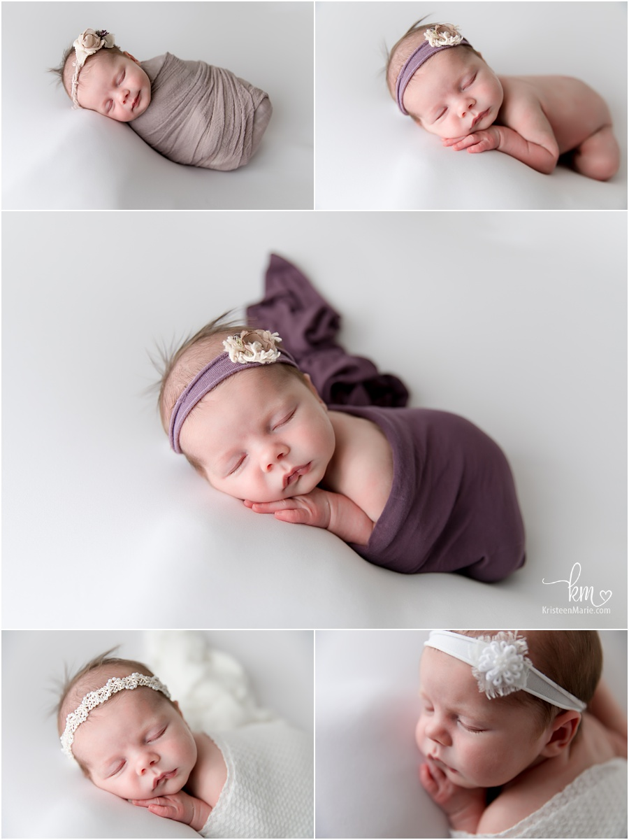 newborn girl on white backdrop with pops of purple