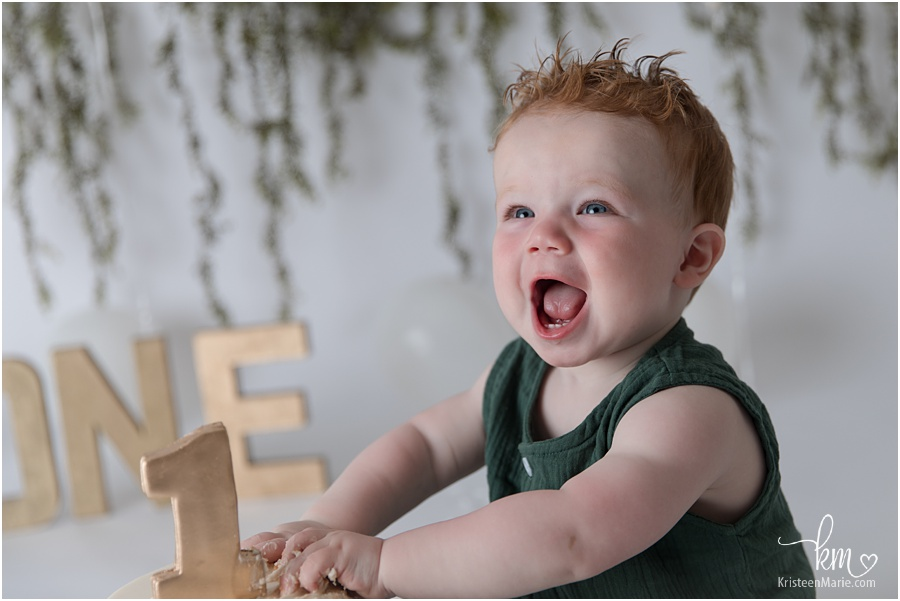 Happy birthday boy wiht red hair and green romper