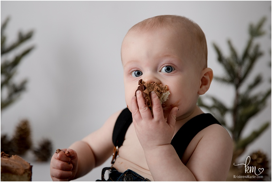 smashing the cake in his face