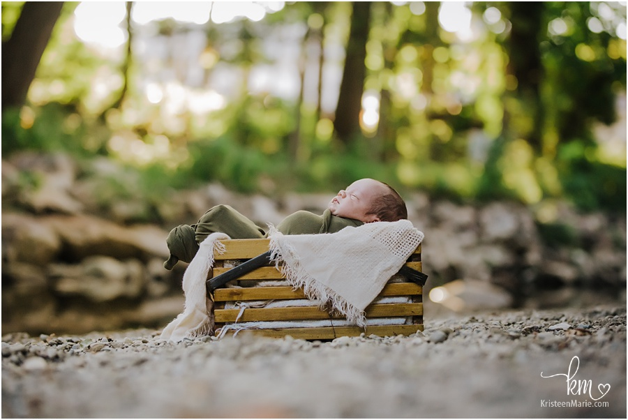 Outdoor newborn photography - baby in a basket
